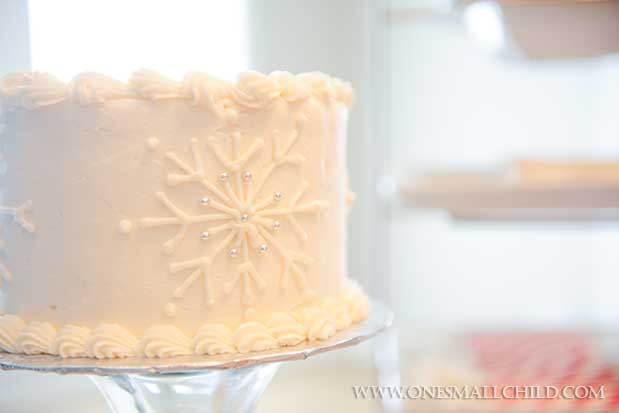 Snowflake Cross Christening Cake | Winter Christening Ideas at One Small Child