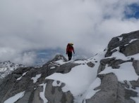 Travel on lightly snow-covered rocks