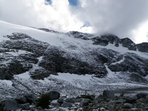 Snow covered cliffs. The glacier has retreated above,  leaving these polished and smooth