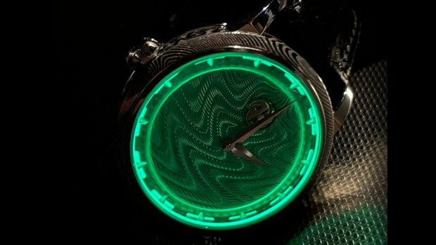 Lume effect on guilloche dial