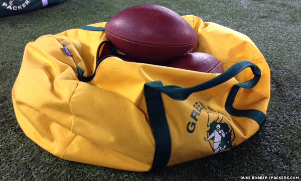 A bag of footballs on the Green Bay sideline