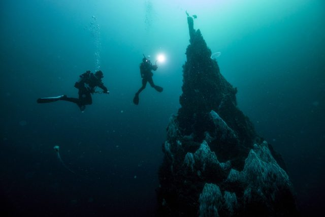 two divers near submerged pinnacle