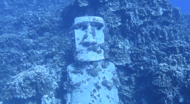 a moai statue underwater in the remote scuba diving location rapa nui also known as Easter Island