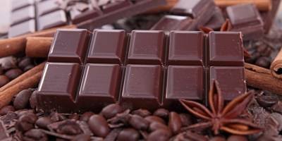 "Chocolate is a typically sweet, usually brown, food preparation of Theobroma cacao seeds, roasted and ground, often flavored, as with vanilla. It is made in the form of a liquid, paste, or in a block, or used as a flavoring ingredient in other sweet foods. Cacao has been cultivated by many cultures for at least three millennia in Mesoamerica. The earliest evidence of use traces to the Mokaya (Mexico and Guatemala), with evidence of chocolate beverages dating back to 1900 BC.[1] In fact, the majority of Mesoamerican people made chocolate beverages, including the Maya and Aztecs,[2] who made it into a beverage known as xocolātl /ʃoˈkolaːt͡ɬ/, a Nahuatl word meaning ""bitter water"". The seeds of the cacao tree have an intense bitter taste and must be fermented to develop the flavor."