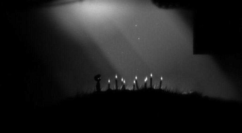 Limbo, imagem do personagem principal e velas acessas no chão