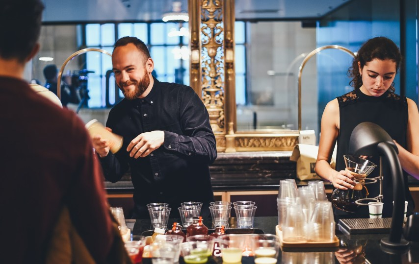 Two people making drinks