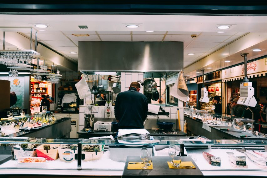 Man standing in center of chef station