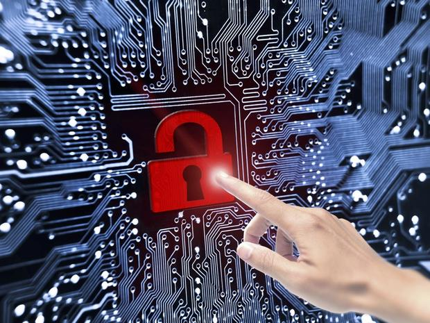 hand pointing to broken security lock symbol on computer circuit board