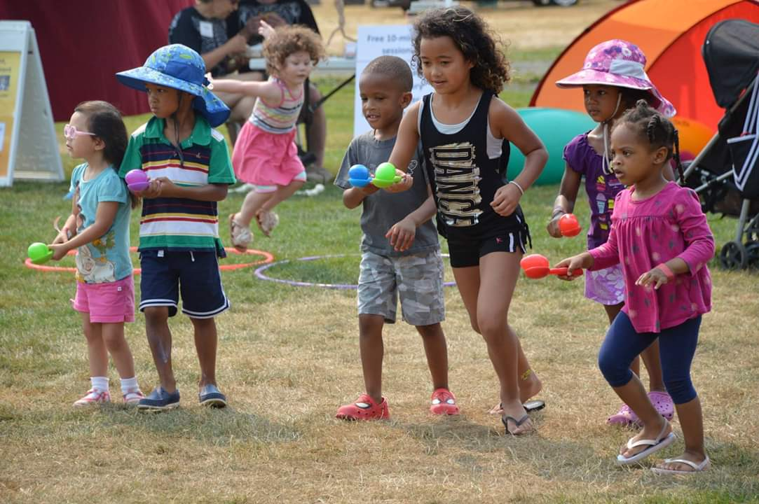 Kids competing in an egg and spoon race