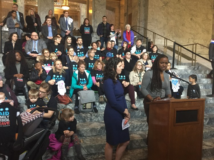 Parents and allies advocating for Paid Family and Medical Leave in Washington State, on the steps of a building in Olympia