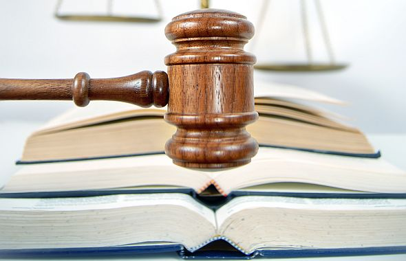 Photograph of a gavel and three open books