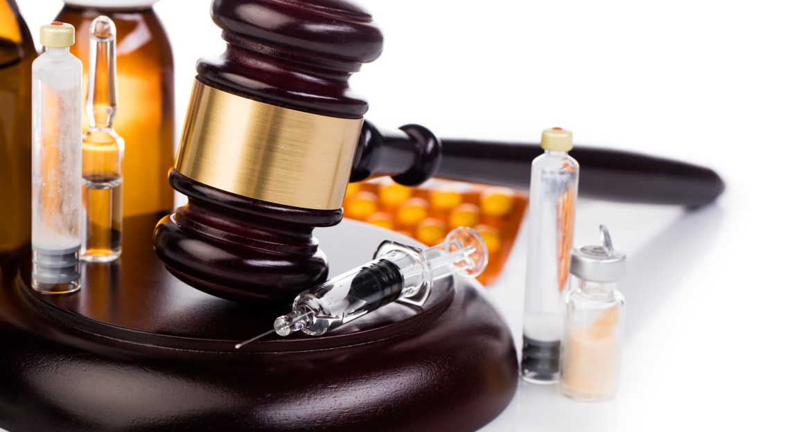 gavel lying with medicines and drugs