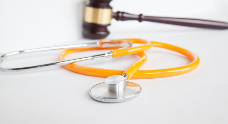 gavel and stethoscope on white background