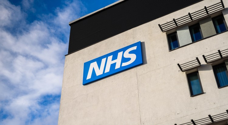 the NHS logo on the side of a building