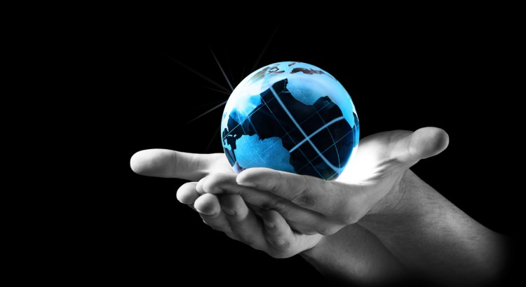 Picture of hands holding up a small globe