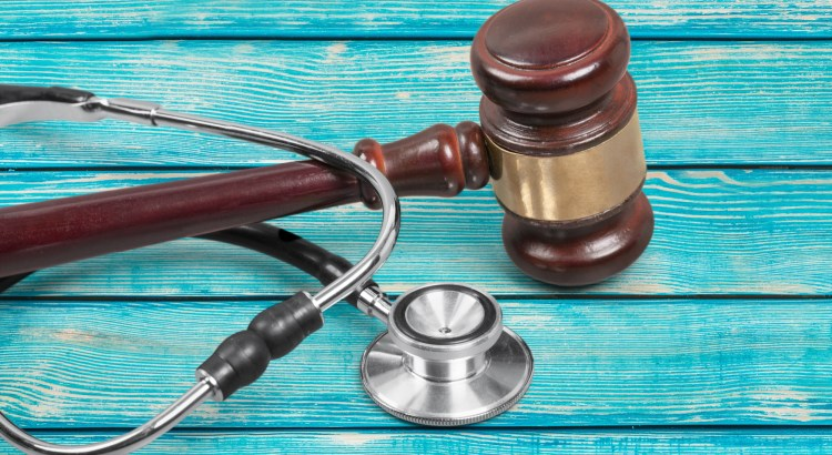 Image of a gavel and stethoscope on top of each other