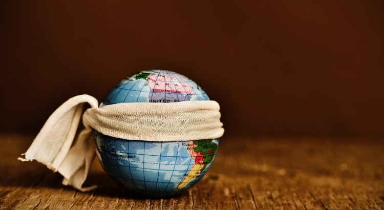 Photo of a globe with a bandage tied around it