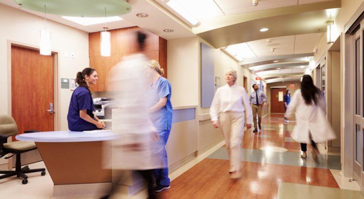 Busy Nurse's Station In Modern Hospital