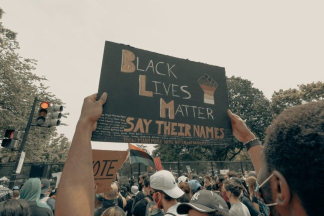 Man holds up a sign at the Black Lives Matter protest in Washington DC 6/6/2020.