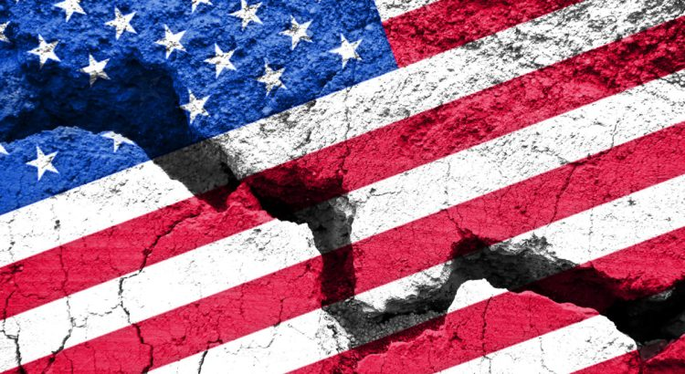 America divided concept, american flag on cracked background.