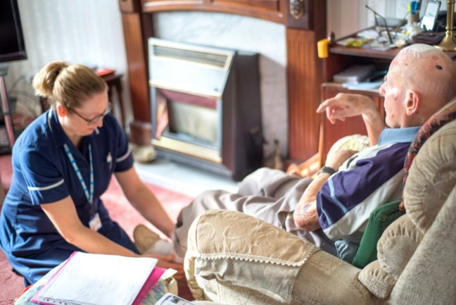 ANDOVER,HAMPSHIRE/UNITED KINGDOM-NOVEMBER 6 2019:A district nurse visits a ninety-four year old patient at his home to treat for pulmonary edema and head/brain injury.