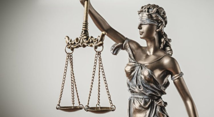 Lady Justice blindfolded with scales.