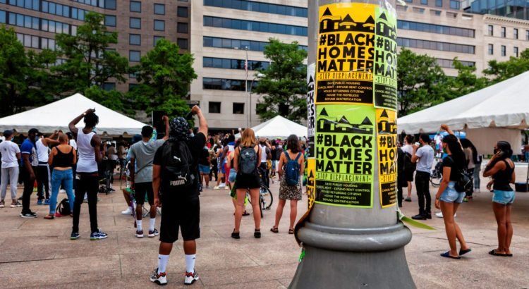 Washington, DC, USA - July 6, 2020: Protesters rally for housing as a human right at Black Homes Matter rally at Freedom Plaza, organized by Empower DC.