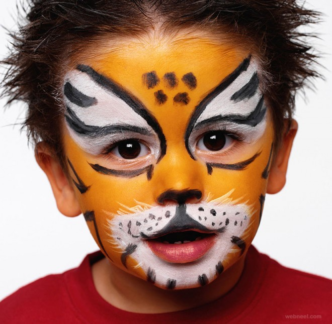 Child with face painted.