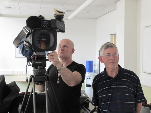 Liverpool physicist John Fry (right) gets ready for his close-up