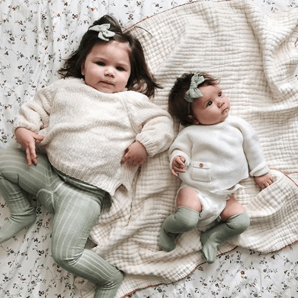 baby and toddler girls in matching outfits