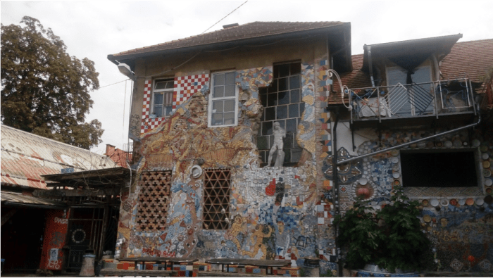 Part of the building was demolished by the Slovene authorities in 1993, the wall was never fixed but was decorated instead to celebrate the autonomy and the struggles of the squatted area. Photo: Nikos Ntounis