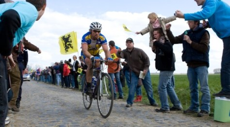 People cheer on riders at Paris-Roubaix