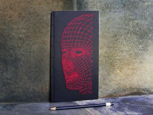 A mesh embroidered on a notebook cover from Fabulous Cat Papers. As original seen on This is Colossal.