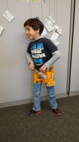 Proudly showing off his finished pajamas. (Used with permission)