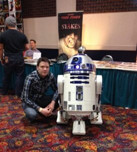 "Todd Jones, creator of the comic book ""Stakes,"" in a recent appearance with R2D2."