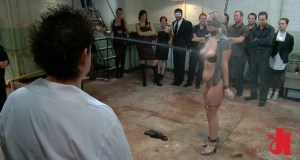 Blonde slave is blindfolded, naked in a basement and has water sprayed over her