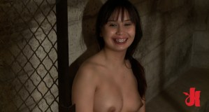 Asian slut with braces waits patiently in her cage for a rough fucking