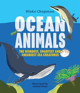 Book cover of Ocean animals featuring illustration of a blue whale and dolphin