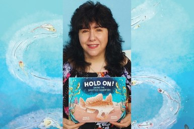 Photo of Gina Newton holding copy of her book Hold On
