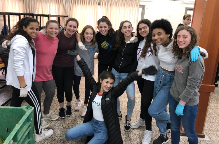 A group of Israeli and American girls pose for a group photo.