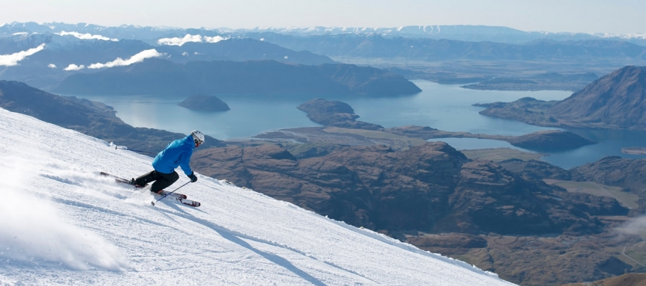 Skier with ocean in background at Treble Cone ski resort