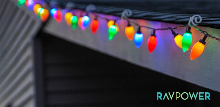 Closeup of multicolored Christmas fairy lights hanging outside a house