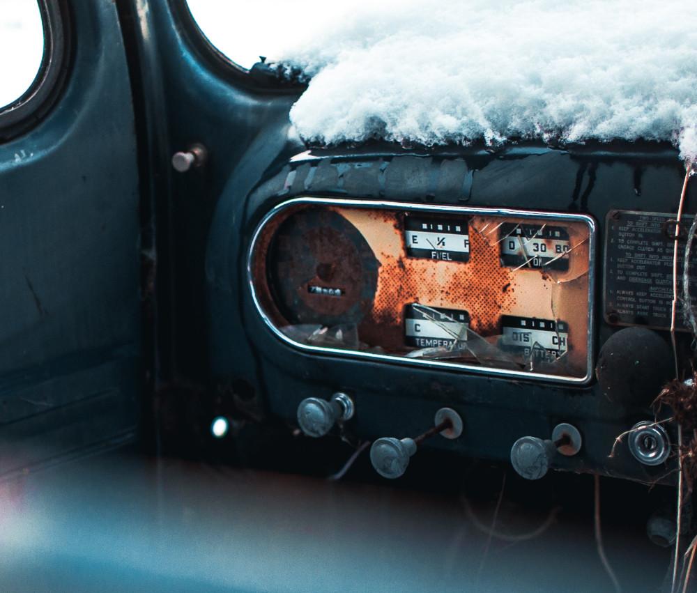 Rusty gadgets on a car's dashboard