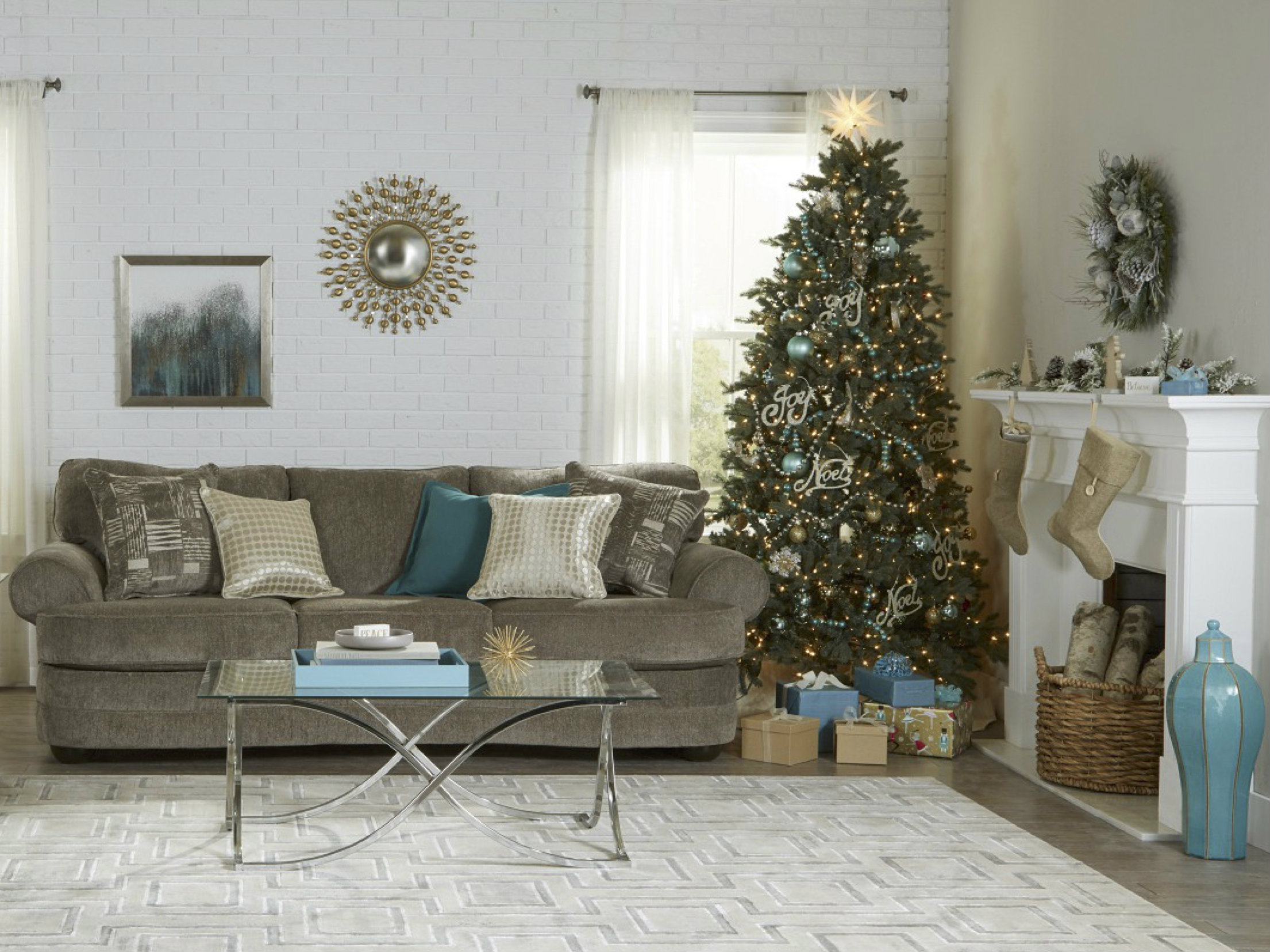 Living room decorated for the holidays with a festive Christmas tree