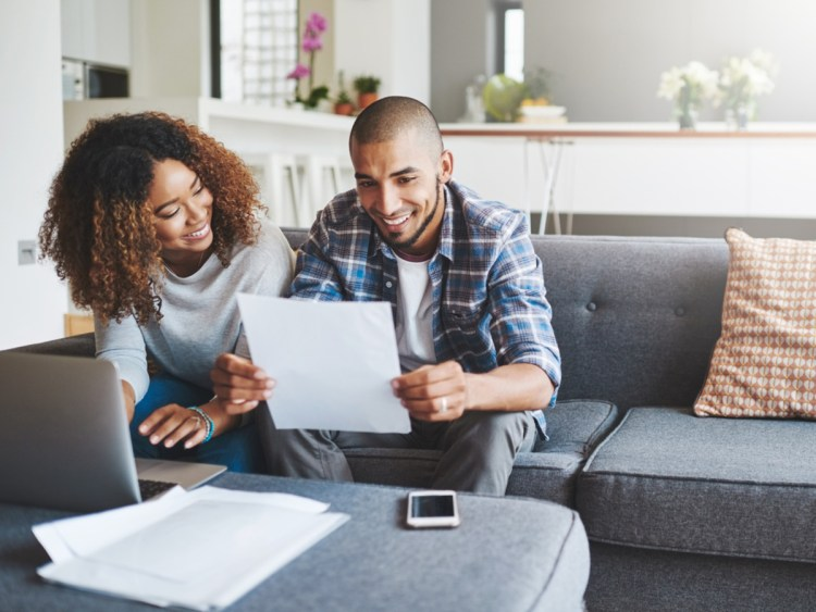 Young couple going through bills and paperwork together