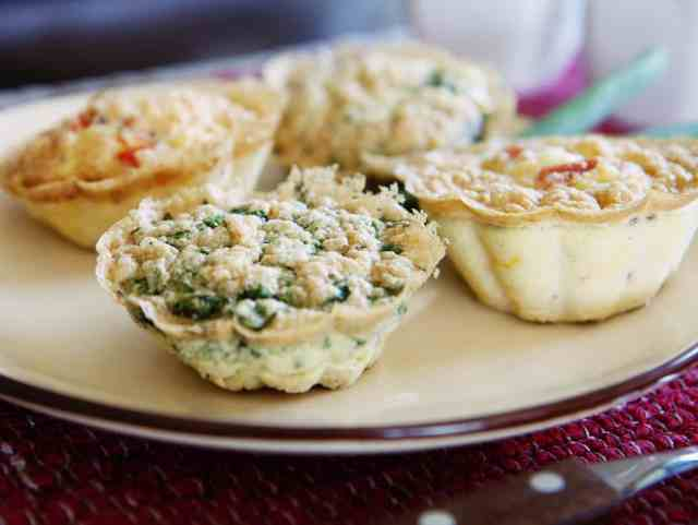 Mini egg quiches on a plate