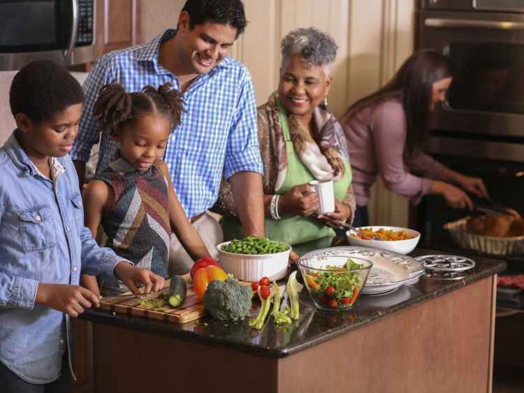 Mixed race family preparing a holiday meal