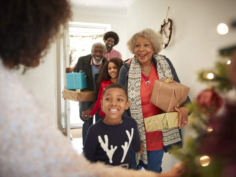 Family walking into house to visit during holidays