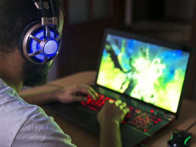 Man playing a video game on a laptop