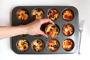 Mini pizzas in a muffin pan